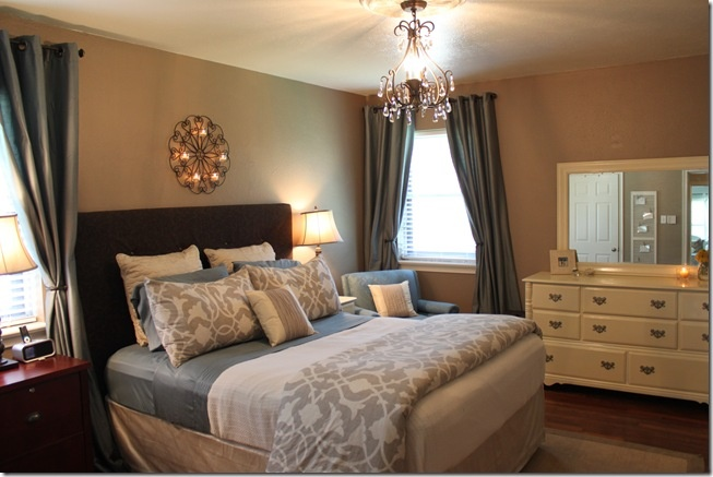 Master Bedroom tan walls love the gray colors don't like white dresser