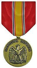 National Defense Service Medal - authorized for his service during the Vietnam War & again during the Persian Gulf War (see ribbon below for multiple war awards - service ribbon with service star representing additional wartime)