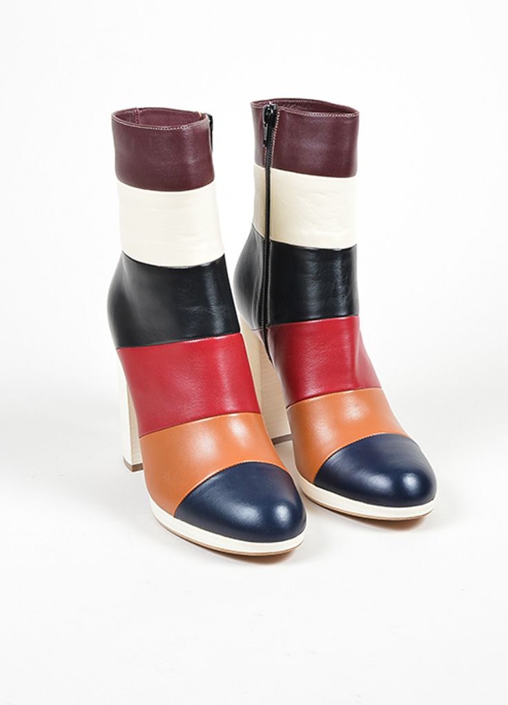 These bold color blocked ankle boots are constructed of multicolor striped…