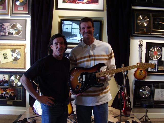 New York Yankee Pitcher Randy Johnson in ROCK STAR gallery with owner Michael.