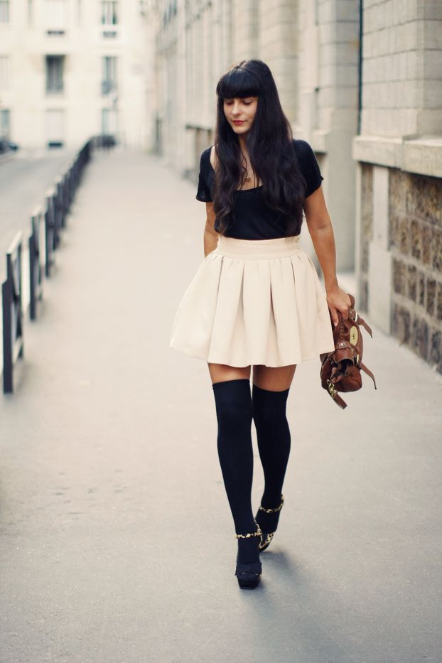 black tee + short wide cream skirt + black parisienne tights + leopard sandals