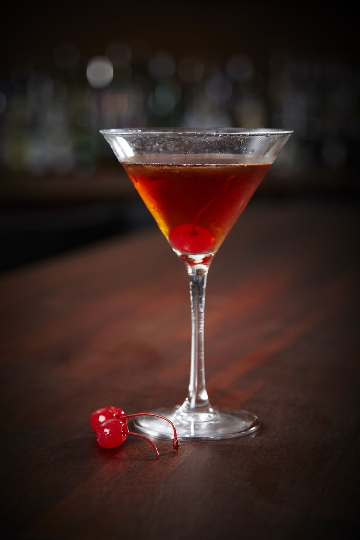Southern Comfort Manhattan Recipe.. 2 (1.5 fluid ounce) jiggers Southern Comfort liqueur 1 (1.5 fluid ounce) jigger sweet vermouth 2 dashes aromatic bitters 4 ice cubes (optional) 1 maraschino cherry