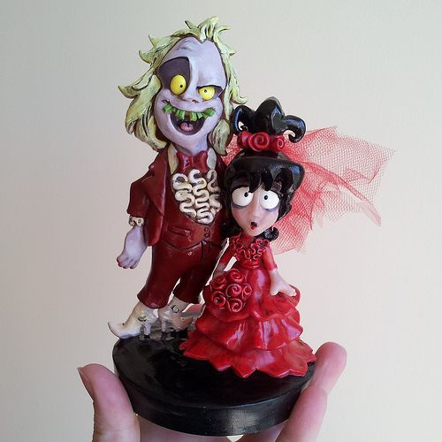 """Beetlejuice And Lydia Cake Topper done by artist Christina Patterson from """"I Do Cake Toppers"""""""