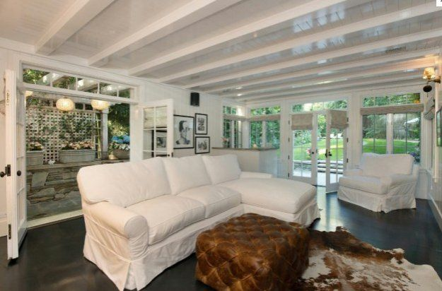 Pin for Later: Guess Which Celebs Have Lived in Jennifer Lawrence's Home?  Dark wooden floors and beamed ceilings are the perfect canvas for a Jennifer Lawrence makeover.  Source: Realtor.com