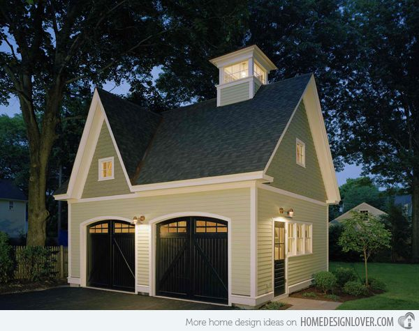 This traditional two door garage is a nice replica of a small Victorian inspired design house