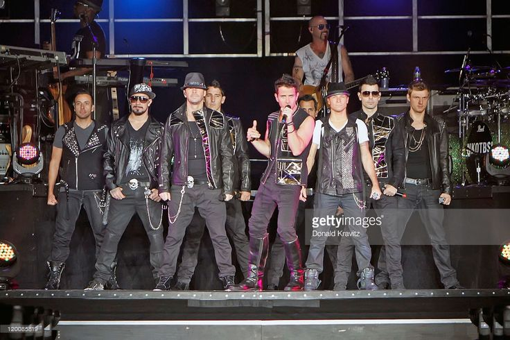 Howie Dorough, A.J. McLean, Donnie Wahlberg, Jonathan Knight, Joey McIntyre, Danny Wood, Brian Littrell, Jordan Knight and Nick Carter of NKOTBSB perform at the Boardwalk Hall Arena on July 29, 2011 in Atlantic City, New Jersey.