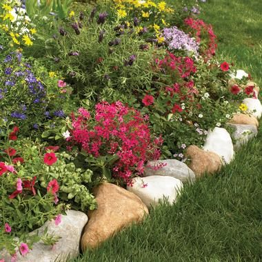 flower bed edging - round rocks! Want to do this in the front yard