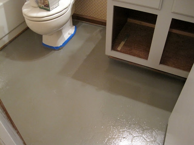 Quick fix for linoleum floors that you are going to replace...someday. Paint them!