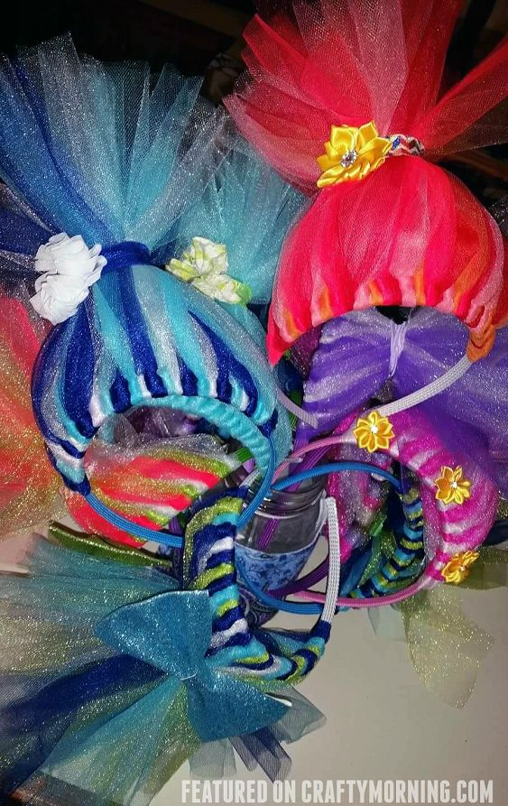 These darling troll headbands were made by Michele Leigh Barney! You could make them for party favors, playing dress-up, etc! They actually stand up too! Directions: Cut approximately 20 pieces of tulle (3 in or 6 in doesn't matter) Cut 12 inch pieces and fold them in half. Loop them around the hard headband and pull …