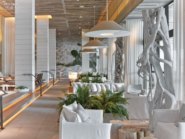 Painted banyan tree trunks help define the lobbys groups of paola navone seating photography by · restaurant barhotel lobby interior designresort