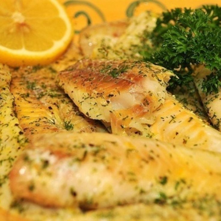 Mouth-Watering Garlic Baked Fish Recipe | Just A Pinch Recipes