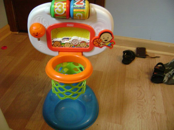 """Fisher Price Basketball Hoop in Angelas' Garage Sale in Wyocena , WI for $8.00. Fisher Price basketball hoop for infants and toddlers.  It has 2 height adjustments--1 for when baby sits up, 1 for when they can stand.  """"Crowd"""" cheers when baby makes a basket.  Comes with 1 ball."""