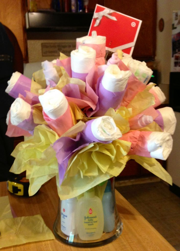 Diaper bouquet! DIY baby shower gift- Maybe could even put 0-12 month onesies as the flowers....
