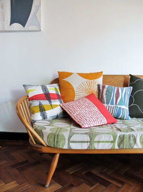 Ercol Daybed with vintage fabric cushions via Skinny Laminx