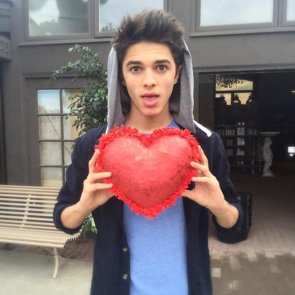 Brent) good news! Lexi's back! Yay! She gave me a heart pillow. I don't know. Remember how she was all quiet before? Yeah. Okay. Well now she won't shut up. She's been singing and wandering around the hospital for an hour...*chuckles*
