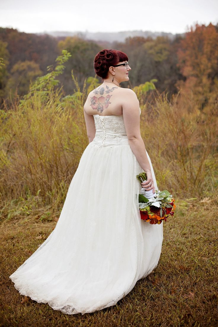 Themed Fall Wedding at the Wyman Center | Eureka, MO | photo by Chrystal Nause Photography (www.chrystalnause.com) |  #chrystalnausephotography #chrystal_nause_photography #borrowedandblue #weddinginspo #everywedding #bride #bridal #tattooedbride #pinupbride #weddingbouquet #bouquet #red #orange #yellow #wedding #weddingphotography #weddings #weddinginspiration #newlyweds #weddinggown #StLouiswedding #StLouisphotographer #Ozarkswedding #WymanCenter #CampWyman #halloweenwedding #fall…