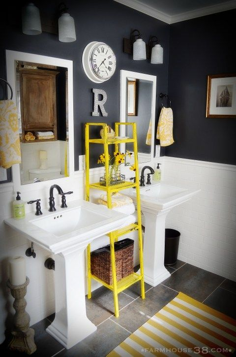 Love the wall color, bead board and the dual pedestal sinks. Would do a more nautical/industrial feel for light fixtures and shelving.