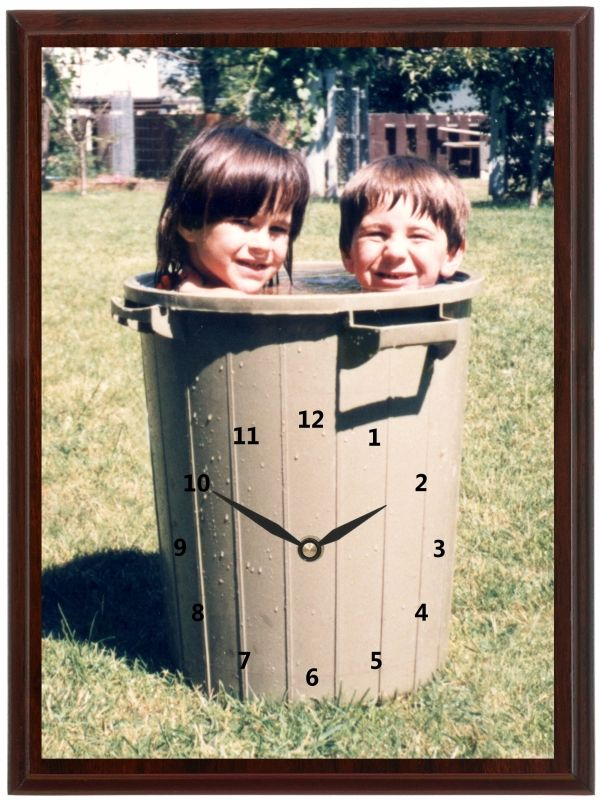 If you don't have a pool in the heat of the summer, this is a great way to cool off. This Kids in the Garbage Clock shows 2 kids cooling off in a garbage can.