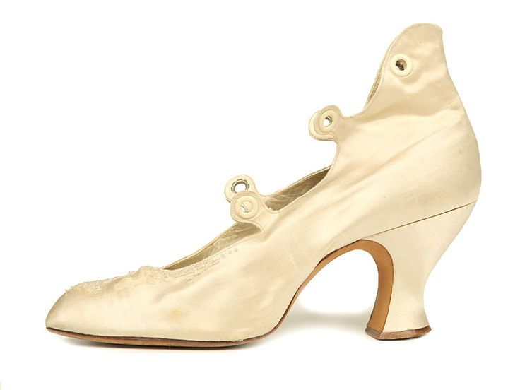 Shoe-Icons / Shoes / Ivory colored satin shoes with Louis heels and high back. Criss-cross front lacing with 3 pairs of eyelets.1880-1890