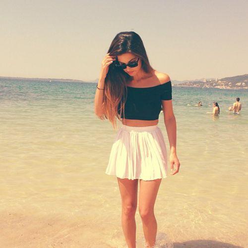 Beach fashion. Vintage. White skirt. Black  cold shoulders blouse.