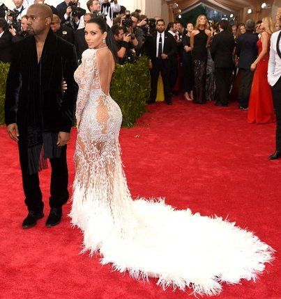 <strong>Kim Kardashian in Roberto Cavalli with Kanye West.</strong> A typically understated look from Ms. Kardashian.