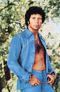 Tom Jones...now I love you very much...but thank fook you are now too old to 'rock' the double denim, shirt open combo!!!