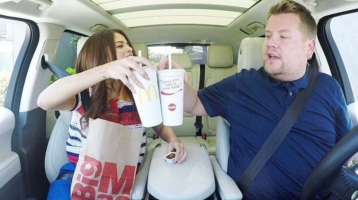 """The eagerly anticipated Selena Gomez edition of """"Carpool Karaoke"""" on """"The Late Late Show with James Coreen"""". They drive thru McDonald's to get a cup with Selena's lyrics   Headline Planet"""
