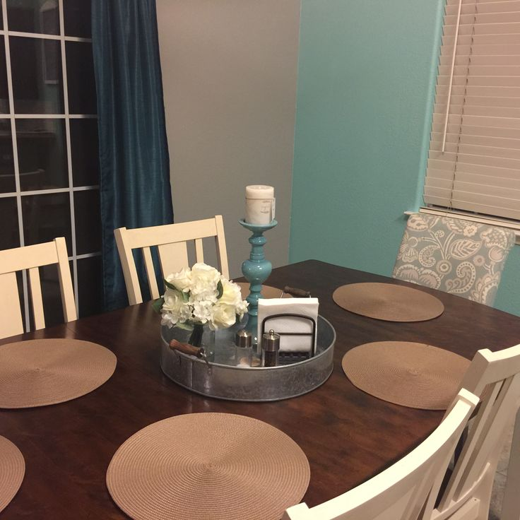 I have a two year old and eating dinner at the table is a daily ritual that I love to do with my family so I wanted a practical but pretty table setting for my farmhouse table. Serving tray with flowers candle stick, napkin holder, salt and pepper shakers and coasters.