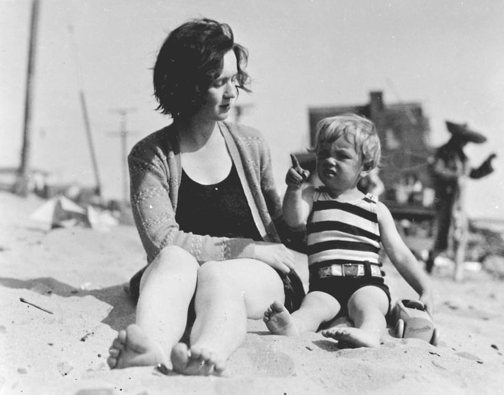 A young Marilyn Monroe with her mother at the beach. Norma on the beach as a toddler with her mother Gladys Baker.