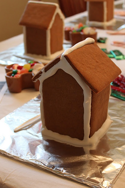 Great ideas for a kid's gingerbread house making party...including setting up the house part before they come and then letting them decorate it themselves at the party.
