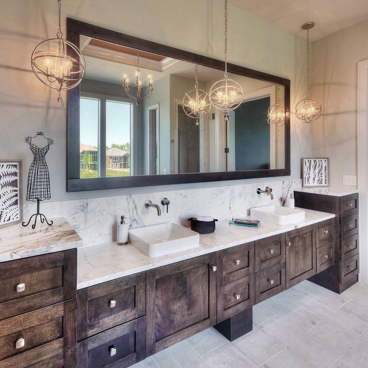 Rustic glam dream bathroom! Love the warm tones and scattered orbit chandeliers 😍 By Starr Homes