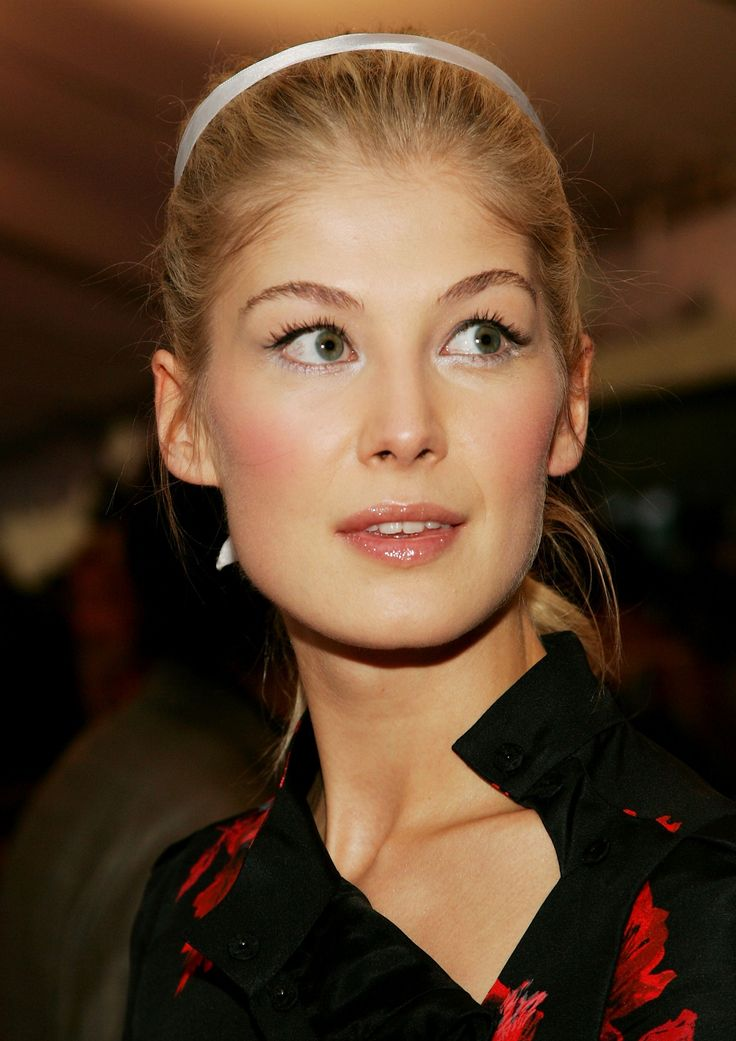 Rosamund Pike -- hooded eyes, all about the lashes
