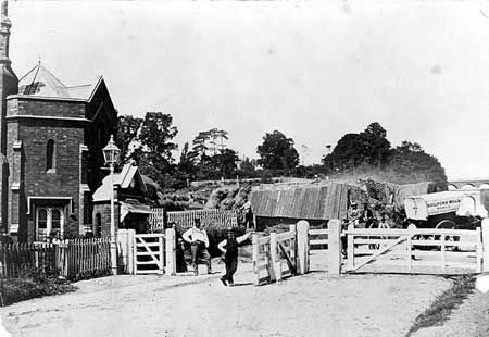 Toll gate on Archway Road, Islington, London This toll gate on Archway Road was removed in 1871. The toll house is visible to the left of the photograph with the toll collector and his family posing for the camera