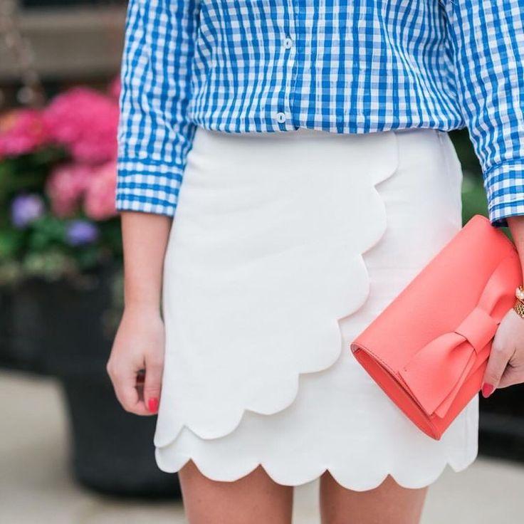 White scalloped skirt & blue gingham blouse.