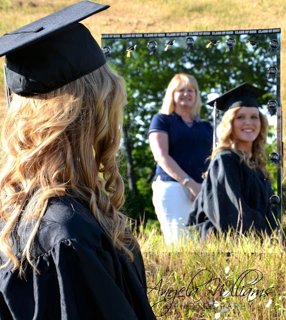 Grandmother looking at granddaughter in mirror -cap & gown photo idea