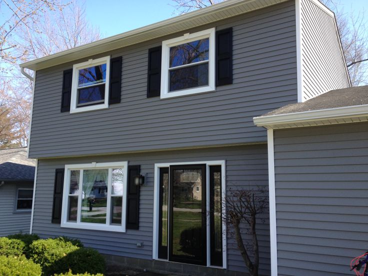Beautiful CertainTeed American Legend vinyl siding installation in the  color Charcoal. we also installed new windows and a front