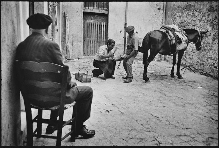 Leonard Freed. ITALY. Sicily. Polizzi Generosa. A blacksmith in the courtyard of a home. 1974.