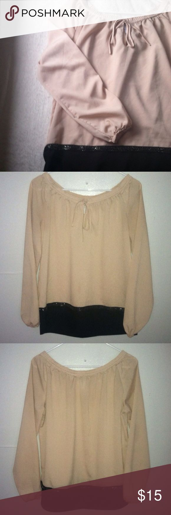 NWOT New York & Company Blouse Top Small • new without tag • embellishment a bit a move the bottom hem • tie at the neckline • round elastic cuffs on the sleeves • color: cream and black • size: small • brand: new york & company • free gift with any purchase • 15% off of all bundles • no trades • New York & Company Tops Blouses