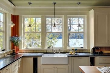 In our kitchen, which also faced south, there was only one small window above the sink. We left that when we remodeled the kitchen, but a couple years later when had some other work done, we removed a large double cabinet to expand the existing window and add two more, similar to this kitchen's design.