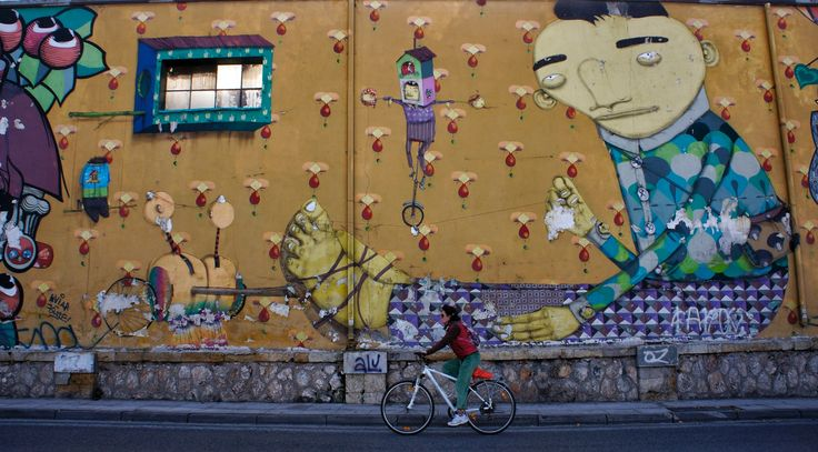 Walls are adorned with works of contemporary graffiti on the streets of Athens.