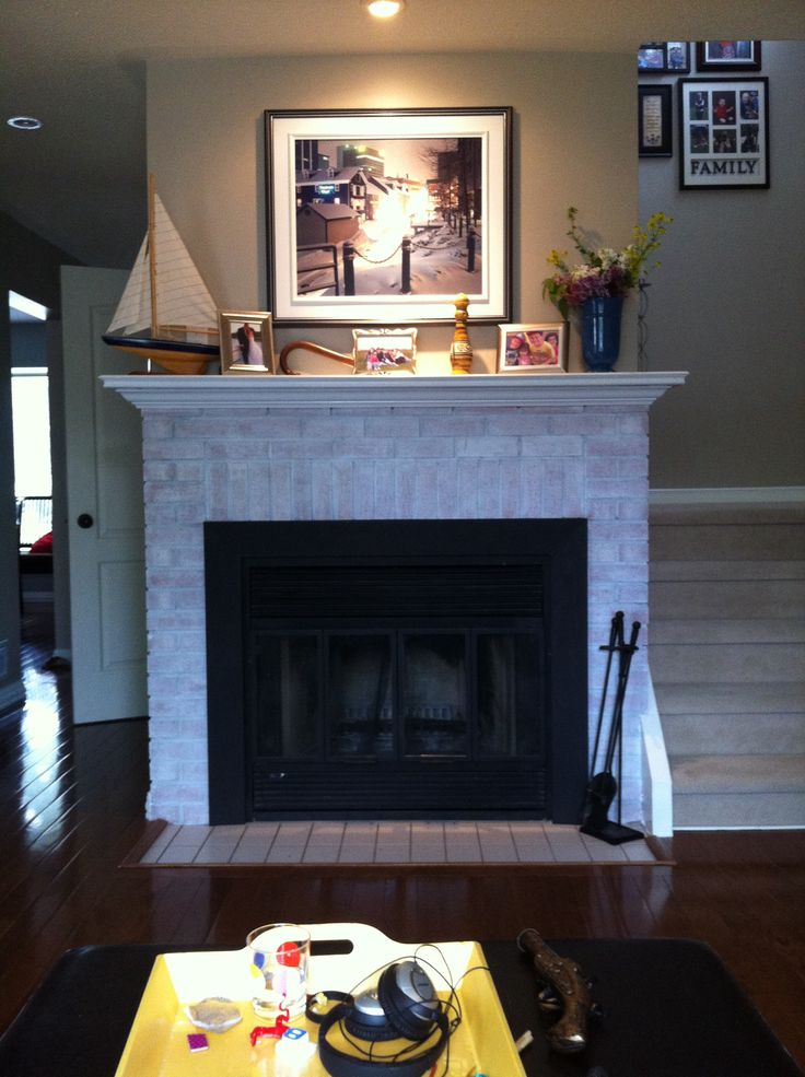 From drab to fab. White washed ugly brick. Brass fire place surround to black with heat resistant  spray paint.