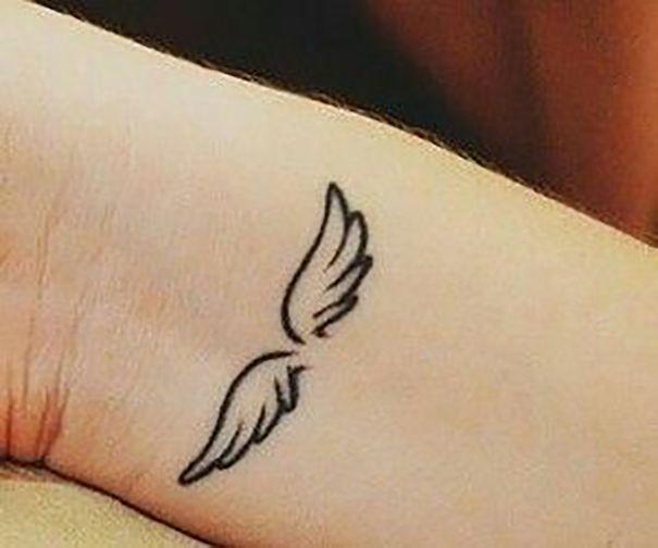 angel wings tattoo  on wrist