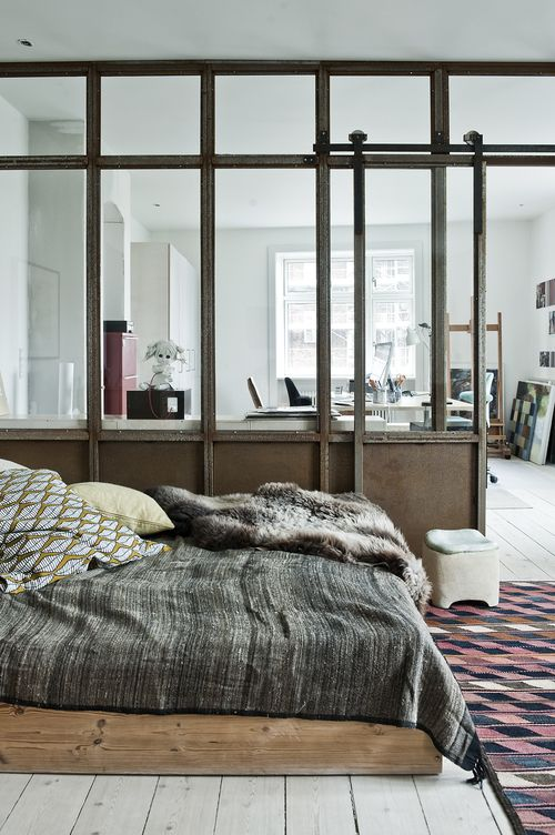 modern rustic, loft living, wood platform bed, glass and wood partition, barn-style door