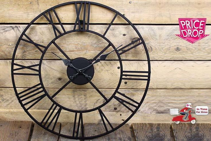 Iron Roman Numeral Clock - 2 Sizes! deal in Art Party like it's 99AD with a Roman numeral wall clock.  Made from iron and perfect for the garden fence or inside your home.  Choose between a 40cm diameter or a larger 60cm diameter.  The skeleton design is inspired by classical French design.  All clocks are handmade and designed to look rustic and vintage.  A stylish addition to your home! BUY NOW for just £14.99