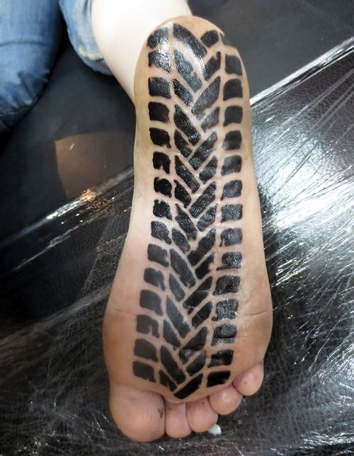 Amanda Zito's fresh tire tread foot tattoo done by Jacob at Dark Star tattoo in Vancouver, WA. Another rad motolady Pacific Northwesterner! There's so many of them! [ more motorcycle tattoos   Blind Thistle & Lazarus ]