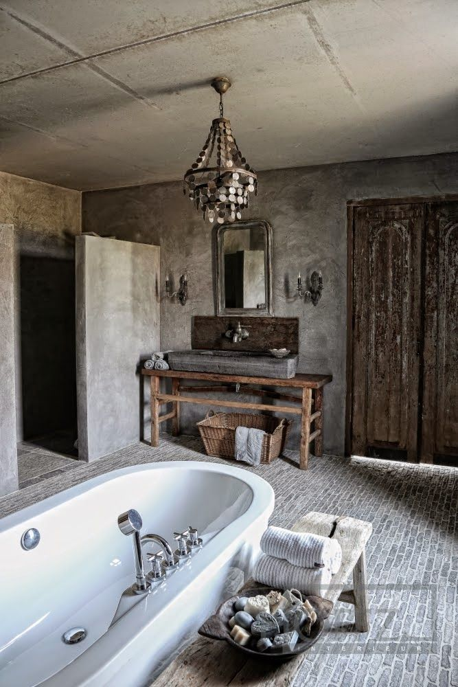 This bathroom is absolutely gorgeous. I love the distressed wood on the doors, and the brick flooring is to die for.