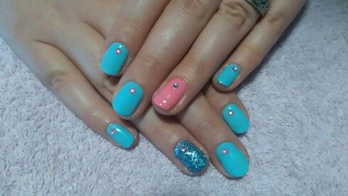 Pink and blue nails with jewels