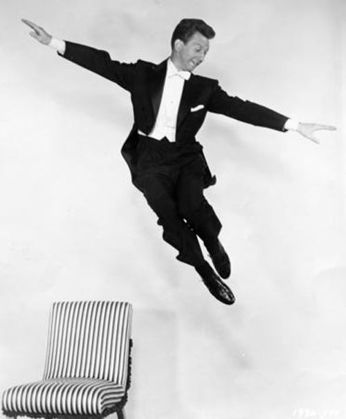 """Actor Donald O'Connor, shown in this 1954 promotional photo from Universal Studios, is best remembered for dancing and flipping on walls in the classic movie, """"Singing in the Rain."""""""