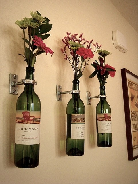 cute idea for wine bottles! I would probably spray paint the holders a bronze-brown color