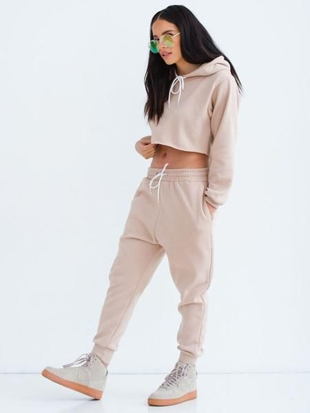 Made for the stylish girl with the tomboy swag. Cropped hooded sweatsuit featuring a drawstring closure on both top and bottoms, made with a cotton blend fabric this sweatsuit gives you the maximum comfort. Reese is wearing a small